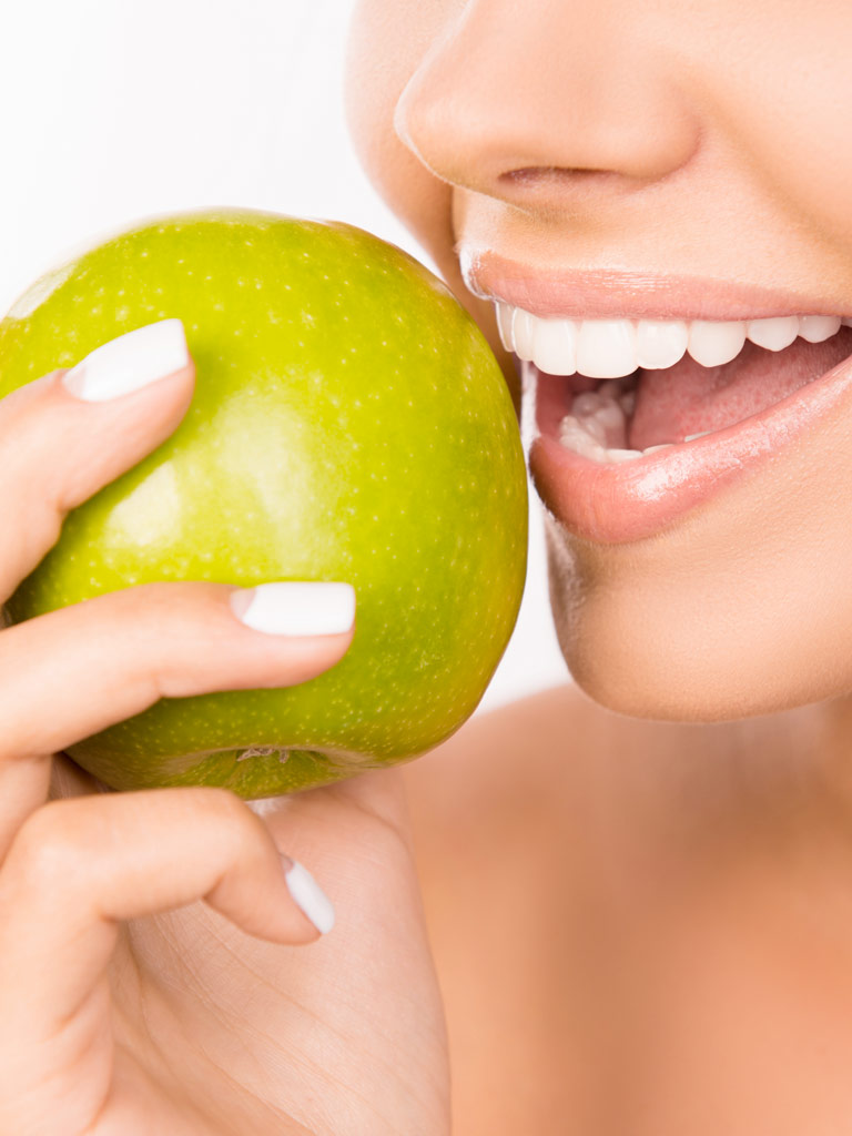 Implants Ad - Woman eating apple